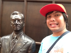 Beside the bust of Manuel Quezon