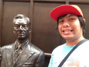 Beside the bust of Manuel Quezon
